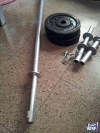 20kg discos + 2 manc+ barra hueca 1.5mt zincada pesas elecc