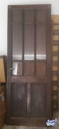 Puerta antigua cedro con postigon